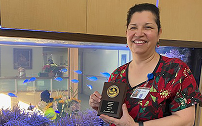 Picture of Fabiola Rios with award